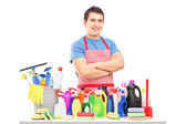 Male cleaner with cleaning products — Stock Photo