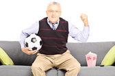 Sport fan holding ball — Stock Photo