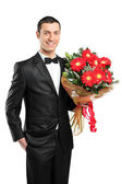 Man holding bouquet of gerberas — Stock Photo