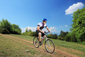 Person riding bicycle — Stock Photo
