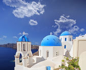 Blue domed church in Oia village — Stock Photo