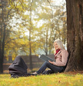 Mother in park with baby — Stock Photo