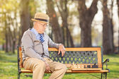 Lonely senior playing chess — Stock Photo