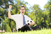 Young cheerful man holding a ball — Stock Photo