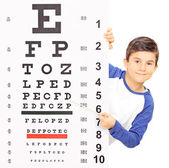 Boy pointing on an eyesight test — Stock Photo