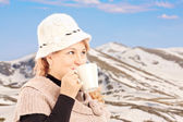 Mature smiling woman drinking tea — Stock Photo