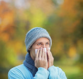 Infected man blowing his nose — Stock Photo