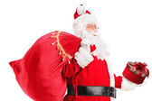Santa Claus carrying bag — Stock Photo