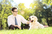 Man with dog in park on grass — Stock Photo
