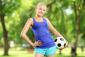 Active female holding a ball — Stock Photo