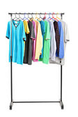Clothes on hang rail — Stock Photo