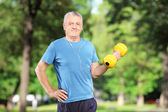 Male exercising with weight — Stock Photo