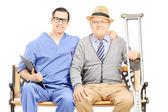 Professional posing with elderly gentleman — Stock Photo