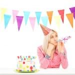 Sad birthday girl with cake — Stock Photo #45890129