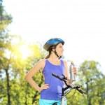 Female biker on a bike — Stock Photo #45890261