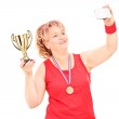Woman holding trophy and taking a selfie — Stock Photo #45890289