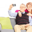 Man and woman taking pictures of themselves — Stock Photo #45891427