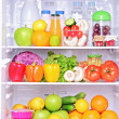 Open fridge with food products — Stock Photo #45892009