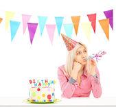 Sad birthday girl with cake — Stock Photo