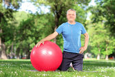 Male exercising with pilates ball — Stock Photo
