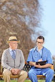 Healthcare professional doing medical check on adult — Stockfoto