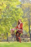Beautiful female on bicycle — Stock Photo