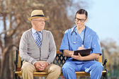 Man and doctor in park — Stock Photo