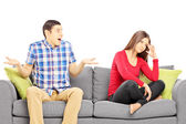 Couple on a sofa during an argument — Stock Photo