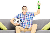 Sport fan with soccer ball and beer — Stock Photo