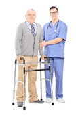 Senior gentleman with walker and doctor — Stock Photo