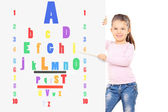 Child pointing on colorful eyesight test — Stock Photo
