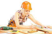 Female carpenter measuring batten — Stock Photo