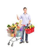 Man holding shopping basket and cart — Stock Photo