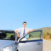 Guy next to his automobile — Stock Photo