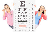 Teenage girls behind eyesight test — Stock Photo