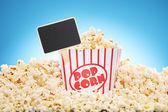 Popcorn in box overflowing — Stock Photo