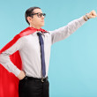 Proud superhero with gripped fist — Stock Photo