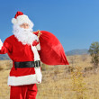Santa hitchhiking on open road — Stock Photo #46591969