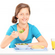 Girl eating toast and salad — Stock Photo