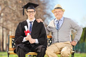 Male graduate with his father — Stock Photo