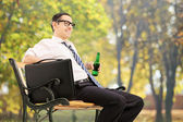 Man holding beer and relaxing — Stock Photo