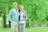 Mature couple standing in park — Stock Photo