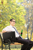 Relaxed businessman taking break in park — Stock Photo