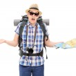Lost male tourist holding map — Stock Photo #48314751