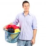 Man holding laundry basket — Stock Photo