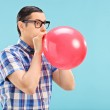 Man blowing up balloon — Stock Photo #48315683