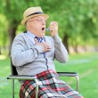 Senior man choking in park — Stock Photo