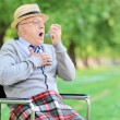Senior man having asthma attack — Stock Photo #48317147
