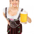 Woman holding pint of beer — Stock Photo #48317577