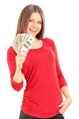 Young woman holding money — Stock Photo